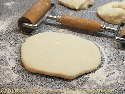 flattened dough with filling